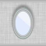 Blank oval picture frame on a gray wall. With fabric texture Royalty Free Stock Photo