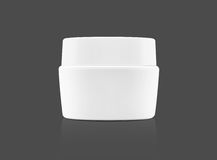 Blank packaging white cosmetic cream pot on gray Royalty Free Stock Photos