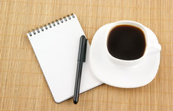 Blank pad of paper with pen and coffee Stock Image