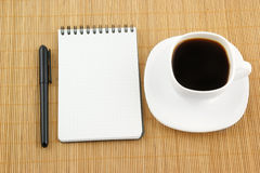 Blank pad of paper with pen and coffee Royalty Free Stock Photo