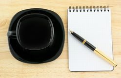 Blank pad of paper with pen and coffee Royalty Free Stock Photos