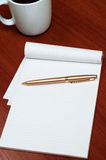 Blank Pad of Paper, Pen and Coffee Royalty Free Stock Image