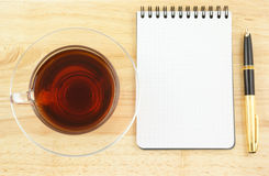 Blank pad of paper with pen and tea Stock Photo