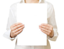 Blank page. Woman holding white paper isolated on white Royalty Free Stock Image
