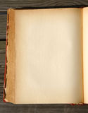 Blank page. Of an old book on wooden background royalty free stock photos