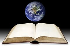 Blank page on book with the earth background Royalty Free Stock Image