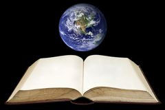 Blank page on book with the earth background. Blank page on book with the earth on the black background Stock Photography