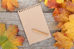 Blank page and colorful autumn maple leaves Royalty Free Stock Image