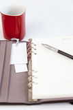 Blank page diary pencil and red cup Royalty Free Stock Images