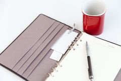 Blank page diary pencil and red cup Royalty Free Stock Photo