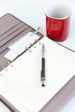 Blank page diary pencil and red cup of coffee Royalty Free Stock Photography