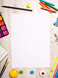 Blank page mockup on table with office tools Royalty Free Stock Photo