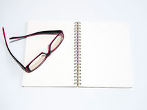 Blank page of a notebook and eyeglasses Stock Photography