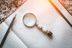 Blank page notebook with a magnifying Stock Image