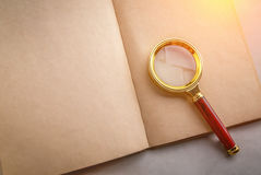 Blank page notebook with a magnifying glass Stock Photography