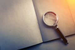 Blank page notebook with a magnifying glass Royalty Free Stock Photo
