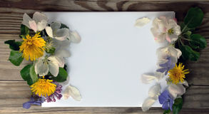 Blank page of a notebook and spring flowers Stock Photography
