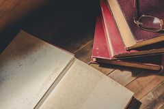 Blank page of old book. Opened old book to blank page for text on wooden table, vintage tone stock photos