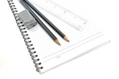 Blank page with pencils, eraser and ruler Stock Photo