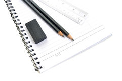Blank page with pencils, eraser and ruler Stock Photos