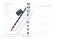 Blank page with pencils, eraser and ruler Stock Images