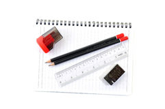 Blank page with pencils, eraser, ruler and sharpener. Isolated on white background Royalty Free Stock Images