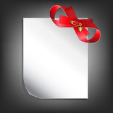Blank page with a red bow Stock Photography