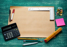 Blank page with work tools on wooden background. Top view.. Stock Photo