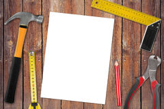 Blank page with work tools on wooden table Stock Images