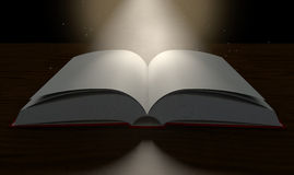 Blank Paged Book Open Spotlight. A regular hard cover book open in the middle with blank white pages on a dramatic dark background lit by an ethereal spotlight Royalty Free Stock Photography