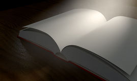 Blank Paged Book Open Spotlight. A regular hard cover book open in the middle with blank white pages on a dramatic dark background lit by an ethereal spotlight Royalty Free Stock Images