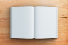Blank pages of diary on brown wooden table. Mock up Stock Photography