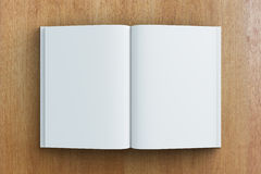 Blank pages of diary on wooden table Stock Images