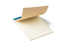 Blank pages of a notebook open slightly. on white background. Royalty Free Stock Images