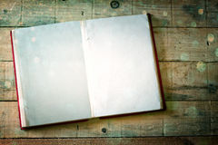 Blank pages of open book over wood table. cross process effect, Royalty Free Stock Photography