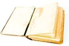 Blank pages of open vintage book. Textured yellowish paper and broken book binding stock photography
