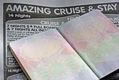 Blank pages on UK passport. Against vacation advertisment in newspaper Stock Photography