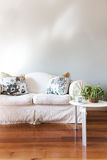 Blank painted grey wall with white country style sofa Stock Photos