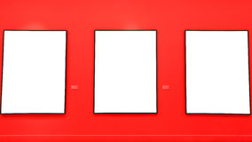 Blank painting frames on red wall Stock Images