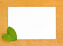 Blank pape and leaf on wooden bords Royalty Free Stock Photography