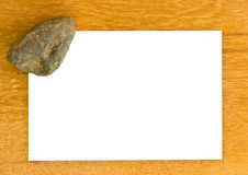 Blank pape and rock on wooden bords Stock Photo