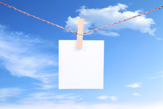 Blank paper. White paper on blue sky background Stock Photography