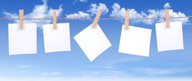 Blank paper. White paper on blue sky background Stock Photo