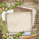 Blank paper with blossoming cherry branch, butterfly, pencil on. Wooden background Stock Photography