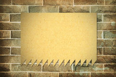 Blank paper on brick wall Royalty Free Stock Photo