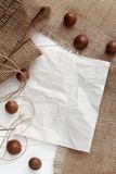 Blank paper on burlap Royalty Free Stock Photos