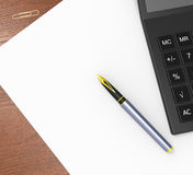 Blank Paper And Calculator Shows Calculating. Blank Paper And Calculator Showing Calculating Copyspace Statistics Royalty Free Stock Photography
