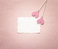 Blank paper card with decorative hearts on a pink polka dots background. Space for text stock photos