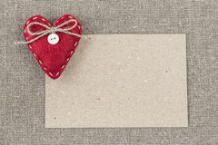 Blank paper card with a red heart Stock Photo