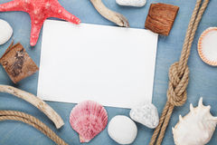 Blank paper card with seashells, ship rope, sea stones Royalty Free Stock Photography
